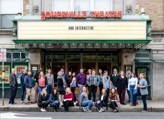 The OHO team sitting in front of the Somerville Theater