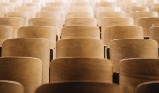 empty chairs representing students that need to be recruited with digital marketing for higher ed