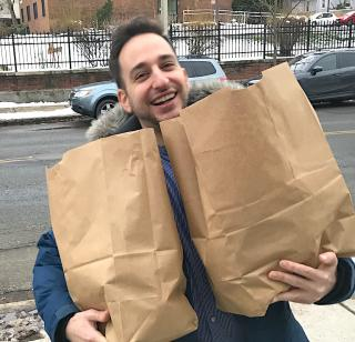 man with grocery bags