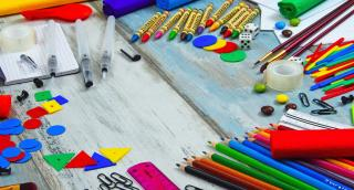A desk covered with school supplies
