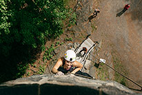 A student rock climbing ans seen from above