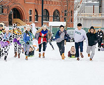 Datmouth students ice skating with big smiles on their faces